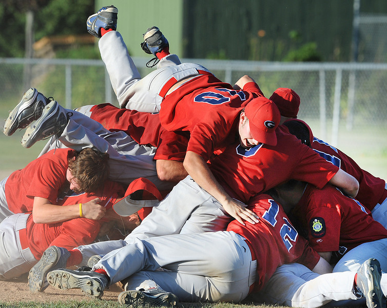 Gayton Post 31 outfielder Joe Sullivan is the last to jump onto the pile as the team celebrates their victory over Augusta to win the Maine American Legion Baseball State Championship in Augusta Sunday.