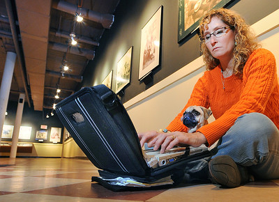Kim Dustin of Hebron works on her computer while she waits for her son at Museum LA during Wednesday's workshop