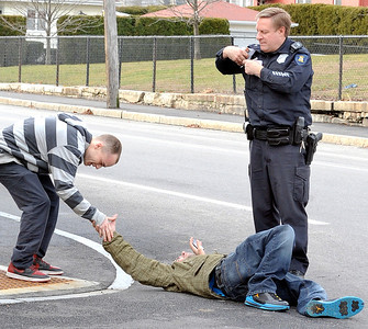 Alexander Hurst, 27, of Lewiston, gets a high five from an unidentified friend after finding out that his injuries were not too serious after being hit by a SUV driven by Bonnie Locke of Lewiston at the corner of Ash and Howe Streets in Lewiston Wednesday afternoon while riding his bike.  Hurst was taken to an area hospital to be evaluated for his injuries.  In the background is Lewiston Police Officer Randy Hausman.