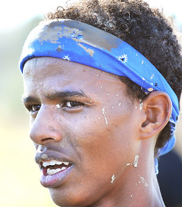 Sweat and mud begins to dry on the face of Mohamed Awil at the finish line after he finished Saturday's 2012 New England Cross Country Championship at Twin Brooks.
