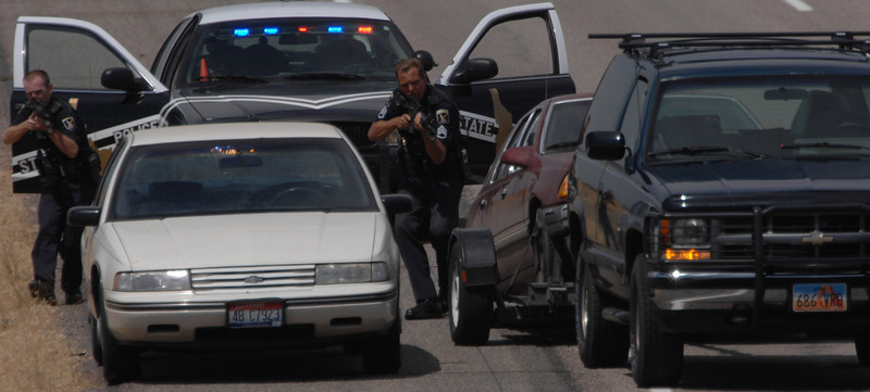 Bill Schaefer/Idaho State Journal<br /> With weapons drawn, Idaho State troopers approach two vehicles during a stand-off on Interstate 15 south of Blackfoot.