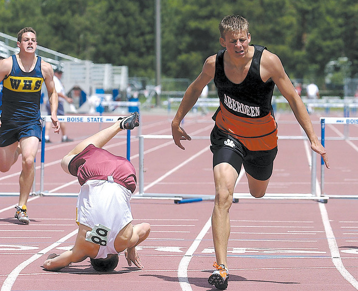 Aberdeen High School's Casey Chappell, right, crosses the finish line to win the 2A 300 high hurdles beating out Kamiah's Spencer Hagen, left, Saturday afternoon at Bronco Stadium.