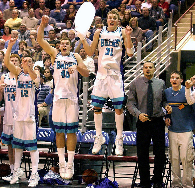 Journal photo by Bill Schaefer<br /> Jumping with joy. Century High School's Nic McAteer (12), Geoff Herzog (40) and Matt Stucki (31) reach new heights as they celebrate the end of their 4A championship game against Burley Saturday night at the Idaho Center.