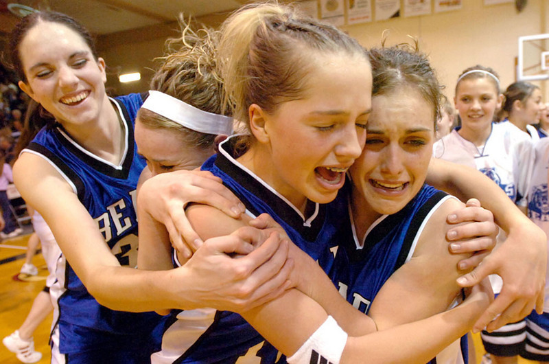 Journal photo by Bill Schaefer<br /> Bear Lake's Natalie Wallentine, left, and Amber Wallentine, right, Shantell Humpherys and Megan Stevens celebrate their come from behind victory over American Falls to win the 3A District 5 championship at Highland High School Tuesday in Pocatello.