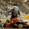 The yellow flag is waved as the 01 kart spins off the track.  (Jenni Farrow)