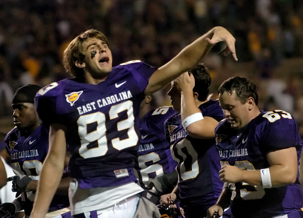 ECU's Steven Rogers yells up to the crowd as the victorious Pirates run off Bagwell field Saturday night.  (Jenni Farrow)