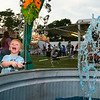 Thomas Brann, 2, fishes for a prize Thursday night at the Winterville Watermelon Festival.  Brann, who was there with his parents Elizabeth and Kenneth of Greenville, took home a stuffed blue dolphin for his fishing prize.