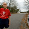 Bill Finch, 96, pauses for a portrait outside his home where he runs in the mornings.