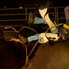 Bull rider Jamie Carter of Kinley, gets tossed off of his bull Friday night during the rodeo competition at the PItt County Fair.  (Jenni Farrow)