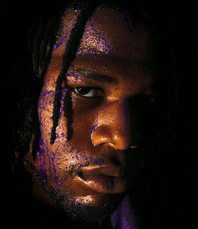 A photo illustration of an ECU football player sweating purple and gold for the cover of Mixer Magazine.