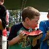 Three boys dive into slices of watermelon during the watermelon eating contest at the Winterville Watermelon Festival Saturday morning.  Left, Zachary Armstrong, 11, took 1st place and Nathan Rice,7, center, took 3rd.