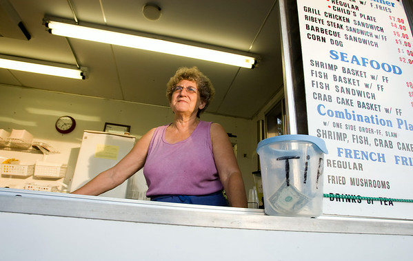 Ann Baker mans the A & B Enterprises concession trailor Thursday night at the Winterville Watermelon Festival she owns along with her husband Bobby.