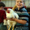 "William Snowden 6 smiles at his parents after receiving a blue ribbon Monday night at the Pitt County Fair for his rooster 'Charles'.  ""I have to tell you, I love my chicken.  I'm glad I showed him"" said Snowden who participated with his sister Heather 7.  <br /> (Jenni Farrow)"