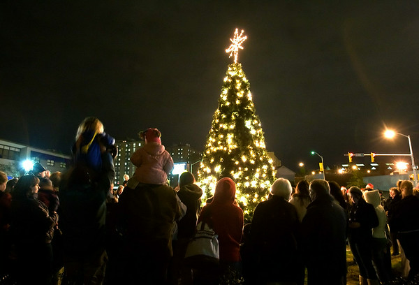 People gather around for the tree lighting ceremony in Greenville Friday evening.