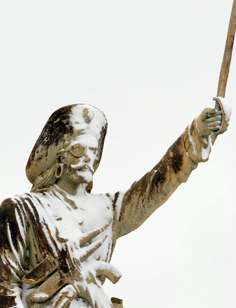 Snow sticks to a pirate statue in front of McAlisters Tuesday morning.