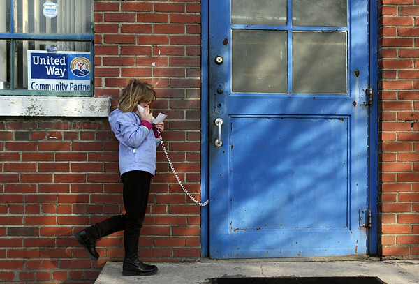 Theresa Cannon 8, stands outside while making a phone call Friday afternoon at the Ayden Boys and Girls Club.  (Jenni Farrow)