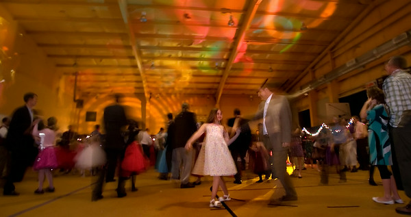 Caught in a brief moment by a flash, Casey Graziosi, 10 and her father Gene, twirl around during the Girl Scouts' Favorite Guy dance at the Boys & Girl's club.  (Jenni Farrow)