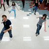 Mike Guzzo and Corena Bristow lead the group in a kicky 'Charlston' moves at the Pitt County Recreation Complex where people can exercise and learn ballroom dancing.