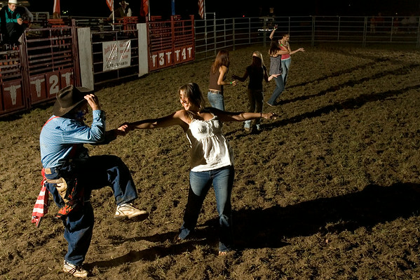 Crystal Morris, 21, a medical assistant from Greenville gets swung around in a dance competition by Roscoe Finley, the rodeo clown, while contestants got set up Friday at the Pitt County Fair.  (Jenni Farrow)