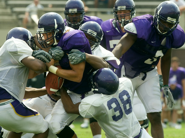 Action from the scrimmage game at Dowdy-Ficklen Saturday.  (I do not have any shots showing this player's number, Nate-can figure it out if you want to use this shot..he was there as well)