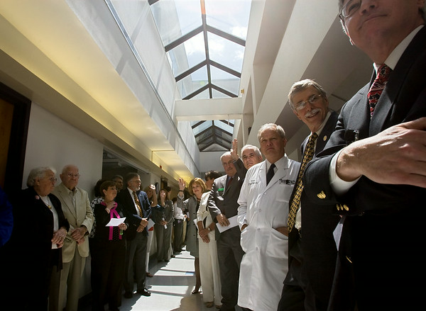Doctors, board members and other distiquished guests line the corridor to the CyberKnife in the Leo Jenkins Cancer Center for the ribbon cutting ceremony and open house.
