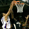 East Carolina's Darrius Morrow (1) goes up to the net against Wake Forest's Al-Farouq Aminu (1) in the second half of Saturday night's game in Minges Coliseum.