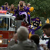 Pee Dee and the Pirate Cheerleaders throw candy from atop a firetruck during the ECU Homecoming Parade Saturday morning on 5th street.