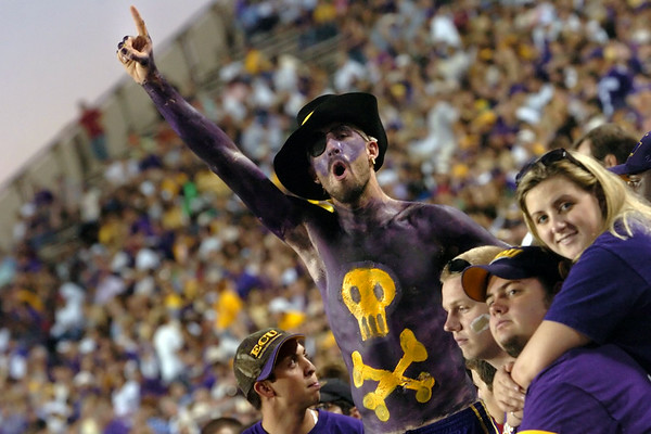 ECU Senior Tim Rugg and friends cheer the Pirates to victory against Memphis.  Rugg hasn't missed a game in 5 years.  (Jenni Farrow)