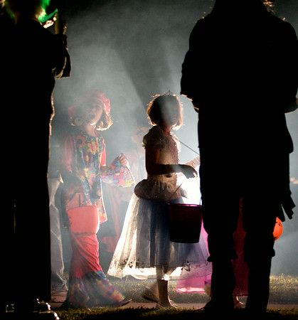 Trick-or-treators get a scare from mechanical ghouls as they pass to retrieve their candy at a residence on Bloomsbury Road in Greenville Halloween night.