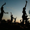 J.H. Rose Cheerleaders spur on the crowd Friday night as the sun sets in Greenville as the Rampants took on D.H. Conley.