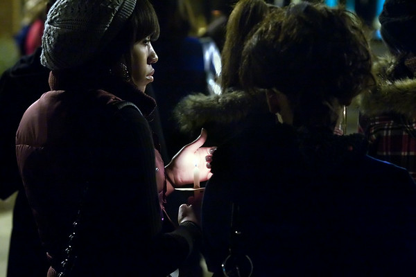 East Carolina Freshman Najah Farooq stands quietly during the vigil on campus Monday evening in honor of Martin Luther King Day.