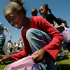 Makayla Best, 8, picks up an easter egg at the Winterville Recreation Park's Easter Egg Hunt Sunday afternoon.