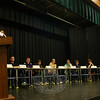 Newtown Middle School Principal Diane Sherlock (at the podium), reads a question from this year's National Geographic Geography Bee competition to the nine top geography bee students from the school on Friday, January 8.  (Hallabeck photo)