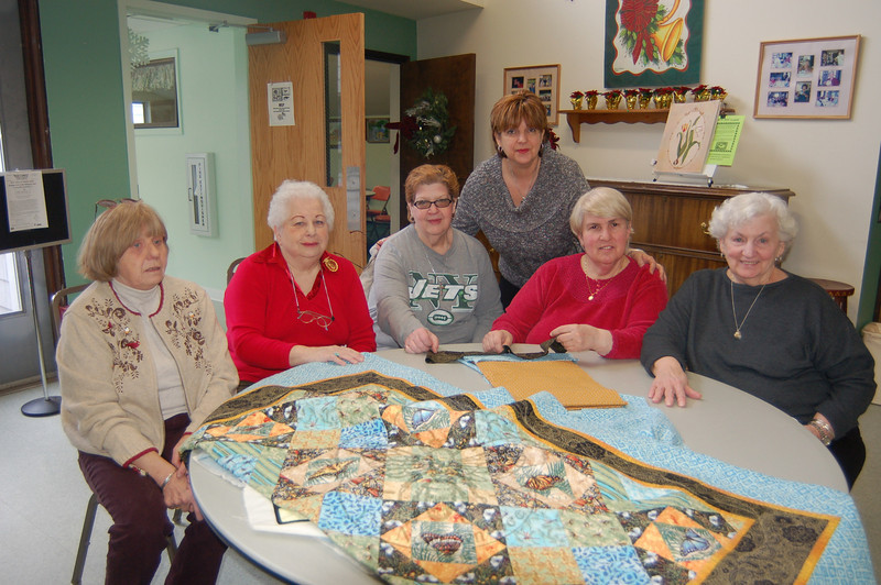 Each Quilt of Valor sent to a service man or woman arrives in a matching quilted case created by The Newtown Senior Center Quilters. From left is Sylvia Krug, Luella Dwyer, Marianne Posser, Marilyn Place, Ida Reiske, and Terry Curry.  (Crevier photo)