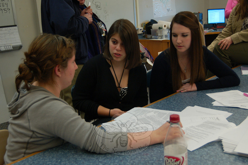 Newtown High School student KellyAnne Brophy (left), with Brookfield High School stu-dents Leanne Pizzo (center) and Jenna Kline, worked together on Tuesday, January 12, at NHS on a presentation funded by a grant through Education Connection to teacher eighth through tenth grade students about online safety.  (Hallabeck photo)