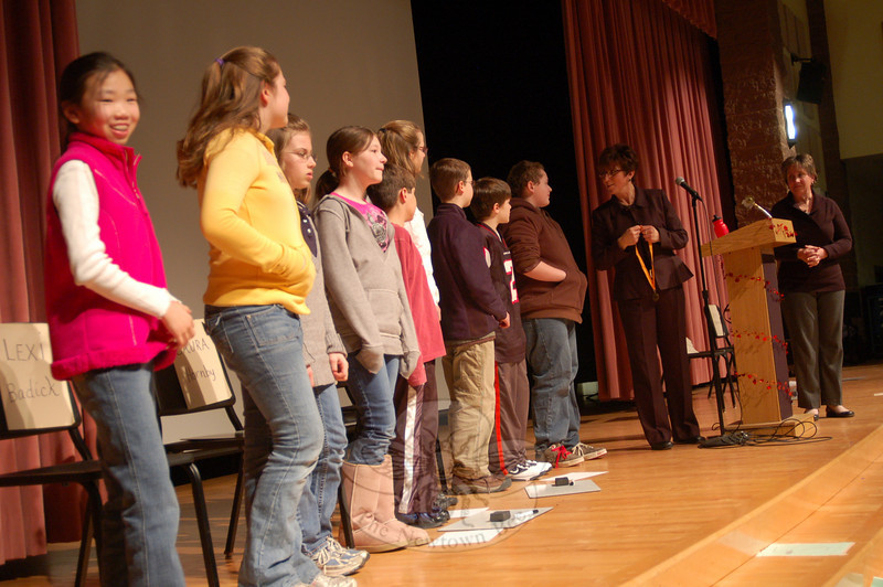 Reed Intermediate School teacher Maura Drabik, at right, and Principal Sharon Epple acted as judge and moderator, respectively, for the National Geographic Geography Bee held at the school Wednesday, January 13. Above, all of the contestants stand together after the event.  (Hallabeck photo)