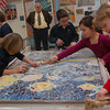 "Head O' Meadow Principal William Bircher looked on while third grade students finished up a tile creation of Vincent van Gogh's ""Starry Night"" that became a permanent installation in the school's front foyer on Wednesday, January 13.  (Hallabeck photo)"