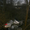 Sandy Hook firefighters worked to extricate two women from a 200 Mercury Sable following a one-car accident on Interstate 84 West on the afternoon of January 20, in which the vehicle they were traveling went off the westbound lanes of highway and traveled down a ravine in the highway median, landing in a stream. On the morning of January 21, driver Cheryl Ann Peters, 63, of Seymour was good condition, and her mother, passenger Charlotte Peters, 87, of Oxford was in fair condition, a hospital spokeswoman said. Ms Peters was driving the sedan westward on I-84 in the right lane of three lanes, in the area between the Bancroft Road overpass and the Philo Curtis Road overpass, at about 4 pm, when the vehicle went out of control and then collided with steel guardcabling on the left road shoulder. The vehicle then went down a steep embankment. Firefighters removed parts of the vehicle to free the women from the wreckage.  The incident was complicated by its location in a stream at the base of the ravine, said Sandy Hook Chief Bill Halstead. Sandy Hook and Hook & Ladder firefighters responded to the accident, as did Newtown Volunteer Ambulance Corps and the paramedic. Although the accident involved the wetbound lanes of traffic, I-84 East was affected by rubberneckers, as can be seen in the upper portion of this photo.  (Hicks photo)