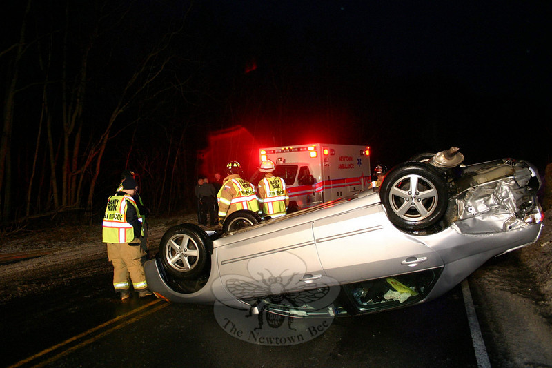 This 2003 Honda Accord sedan came to rest upside down on Berkshire Road (Route 34), west of Bennetts Bridge Road, about 4:40 pm January 17 in a one-car accident. Police said motorist Matthew Leone, 44, of Milford was driving the Honda westward on Berkshire Road, when he skidded on the icy pavement, entered the eastbound lane and then attempted to correct for the skid, but the vehicle went out of control and rolled over, landing on its roof. Sandy Hook firefighters and ambulance volunteers went to the scene. Leone declined medical attention and, following an investigation, police charged Leone with driving under the influence and with making a restricted turn. Leone was released on $100 bail for a February 2 court appearance. The incident caused travel delays in the area, resulting in detours around the section of Berkshire Road where the accident occurred.  (Hicks photo)