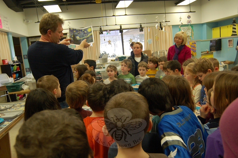 "Bruce Hunter, co-owner of The Art Spot, a Danbury studio that offers art classes for children and adults, explained to Head O' Meadow first grade students on January 11 that they would be working on four panels for a schoolwide project re-creating Vincent van Gogh's ""Starry Night.""  (Hallabeck photo)"