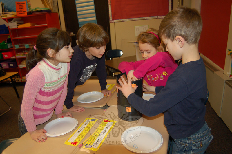 Kaitlyn Tripodi, Brett Bromberg, Jane Shearin and Quinn McAndrews (from left), second graders in Liesl Fressola's class at Head O' Meadow, worked to sample soil while learning about the process from Audubon Society education coordinator Carol Kratzman on Monday, January 11.  (Hallabeck photo)