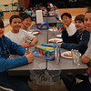 Newtown students, from left, Chris Morlock, Lincoln Gray, Evan Lee, Sean Lee, Gabriel Barrett. and Owen Gray sit together as a team at the second annual Odyssey of The Mind Spontaneous Scrimmage held at Reed Intermediate School on January 14 for Newtown and Brookfield teams.  (Hallabeck photo)