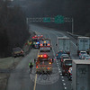 Two women were admitted to Danbury Hospital as patients following a one-car accident on Interstate 84 West about one-half mile before Exit 11 on the afternoon of January 20, in which the 2000 Mercury Sable in which they were traveling went off the westbound lanes of highway and traveled down a ravine in the highway median, landing in a stream. As seen from the overpass on Bancroft Road, westbound traffic was temporarily at a standstill as emergency crews arrived on the scene. One the roadway was reopened, with the high speed lane still closed, traffic was slowed for about two hours as the scene was cleared.  (Gorosko photo)