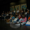 "The cast of ""The Music Man,"" this year's Newtown Middle School musical, sat together on stage in the school's auditorium during rehearsals on January 13.  (Hallabeck photo)"