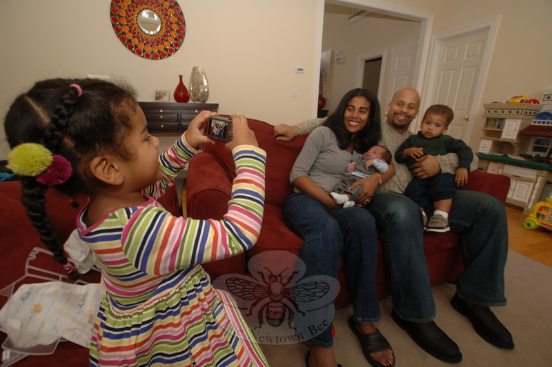 Jordyn Maddox, 4, takes a photo of her parents Nicole and Stephen, younger brother Bryce, and her newborn brother Spencer. Spencer is Newtown's First Baby 2010. (Bobowick photo)