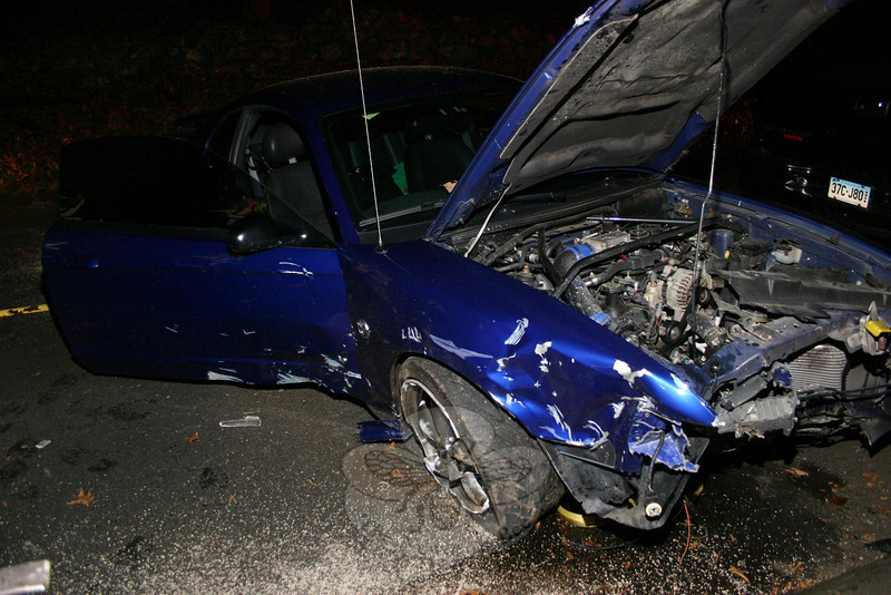 A crash on Hanover Road around 9:30 on November 11 totaled a 2004 Ford Mustang, and resulted in minor injuries to the driver. But it also spawned an argument over the cost of the tow, which led to the driver's father allegedly threatening to shoot a tow truck driver.  (Hicks photo)