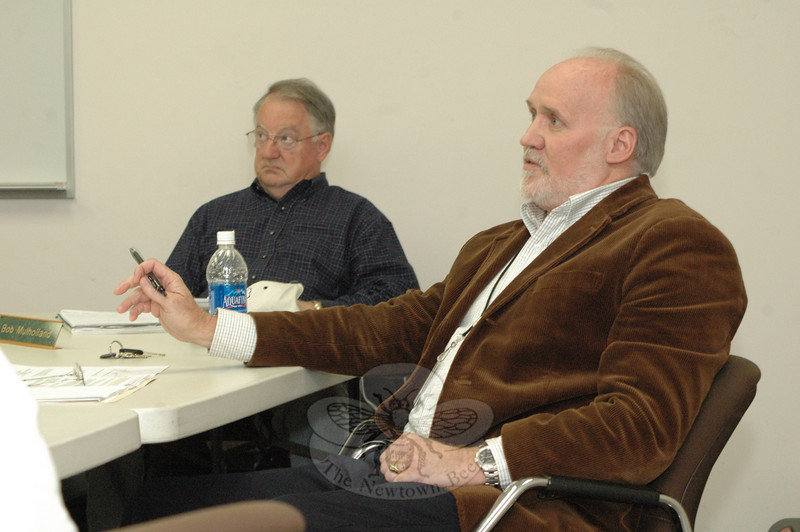 George Benson, the town's director of planning and land use, right, listens during a November 5 discussion on the Planning and Zoning Commission's (P&Z) proposal to create new environmental protection regulations. P&Z member Robert Mulholland is in the background.  (Gorosko photo)