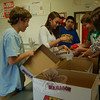From left, Newtown Middle School Student Council President Matt Mossbarger, Treasurer Noelle Benson, and members Jack Lago, Dan Harrison, and Mary Joe Rossi separate food for the council and school's Thanksgiving Food Drive. NMS students are asked to bring in nonperishable food items, without dents or expiration dates, paper products, and Big Y coins to the school through Friday, November 20. Each day Student Council members collect the food and bring it to Linda Dale Mulholland's room to be sorted for the drive.  (Hallabeck photo)