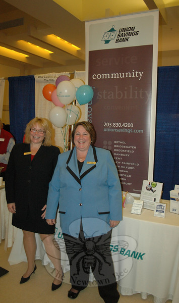 Union Savings Bank mortgage officer Kerry Gulick, left, and Newtown branch manager Peggy Velthuizen were all smiles as they got to know the many visitors to Destination Newtown.  (Voket photo)