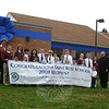 St Rose School faculty and students continue to celebrate their school being named a Blue Ribbon School by the US Department of Education. Most recently, the school building was encircled with a huge blue ribbon and bow, both easily visible from Church Hill Road. Standing with Principal Mary Maloney and Monsignor Robert Weiss on November 10, holding the banner are, from left, front row, St Rose School students Peyton McKenzie, Alyssa Bova, Juan Mendez, Jacob Anthony, Walter Brady, Stella Sabo, Rosie Simms, and Nora Kliczewski. Standing behind them are Genny DeNault, Madeline Meier, Owen Richards, Olivia Adams, Jack Moulder, Noah LaFerriere, Connor McNerney, Peter Johnston, Matt Wood, Thomas Briscoe, Victoria Kirkman, Matt St Jean, and Bridget Moore.  (Hicks photo)